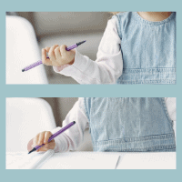 Child holding a pencil with fist